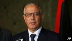 FILE - In this Oct. 8, 2013 file photo, Libyan's Prime Minister Ali Zidan speaks to the media during a press conference in Rabat, Morocco.