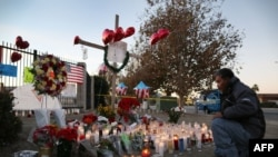 David Lem pays his respects at a memorial near the Inland Regional Center in San Bernardino, Calif., Dec. 5, 2015. Fourteen people were killed at the center on Dec. 2, 2015, in a mass shooting.