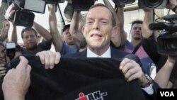 ຜູ້ນໍາພັກຝ່າຍຄ້ານ ທ່ານ Tony Abbott ທີ່ຈະໄດ້ເປັນ ນາຍົກລັດຖະມົນຕີຄົນໃໝ່ ຂອງອອສເຕຣເລຍ.