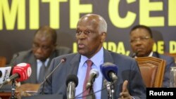 FILE - Angolan President Jose Eduardo dos Santos attends a party central committee meeting in Luanda, Dec. 2 ,2016. He is stepping down after 38 years in power.