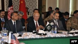 In this handout photograph released by the Associated Press of Pakistan (APP) on February 6, 2016, Pakistani officials chair the third round of four-way peace talks with Afghan, Chinese and U.S. delegates in Islamabad.