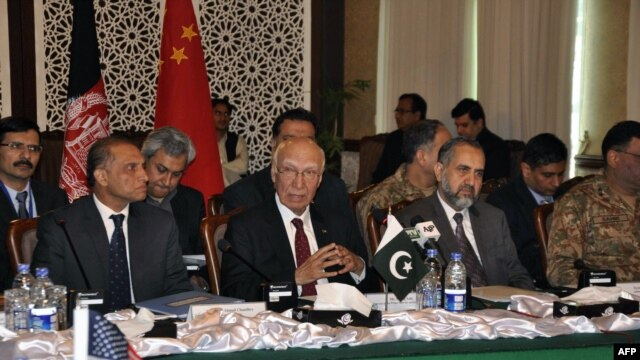 In this handout photograph released by the Associated Press of Pakistan (APP) on Feb. 6, 2016, Pakistan's National Security Advisor Sartaj Aziz (C) chairs the third round of four-way peace talks  with Afghanistan, US and Chinese delegates in Islamabad.
