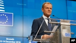European Council President Donald Tusk speaks during a media conference at an EU summit in Brussels, Dec. 14, 2018.
