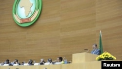 Egypt's President Mohamed Morsi (R) delivers a speech during the opening of the African Union (AU) leaders' meeting in Addis Ababa, July 15, 2012.