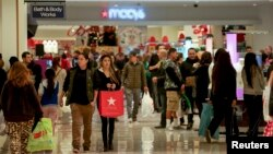 FILE - Shoppers walk inside the Glendale Galleria in Glendale, California.