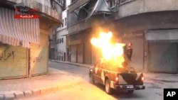 Image from Shaam News Network, which has been authenticated based on its contents and other AP reporting, fighters from the Free Syrian Army targets one of the bastions of the regime's forces in Aleppo, Syria, July 22, 2013.
