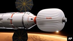 Gambar pesawat yang akan membawa awak ke Mars pada sebuah misi yang dimulai 2018 dan dibiayai jutawan Dennis Tito, turis antariksa pertama.(AP/Inspiration Mars)