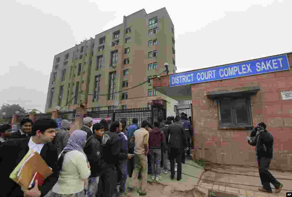Indians stand in a line to enter the District Court complex where a new fast-track court was inaugurated Wednesday to deal specifically with crimes against women, in New Delhi, India, January 3, 2013.