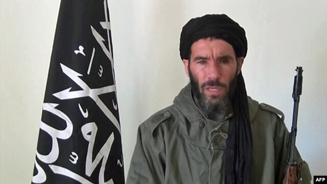 FILE - Undated photo obtained by ANI Mauritanian news agency reportedly shows former Al-Qaida in the Islamic Maghreb (AQIM) emir Mokhtar Belmokhtar speaking at an undisclosed location.