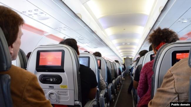 Passengers relax during a flight.