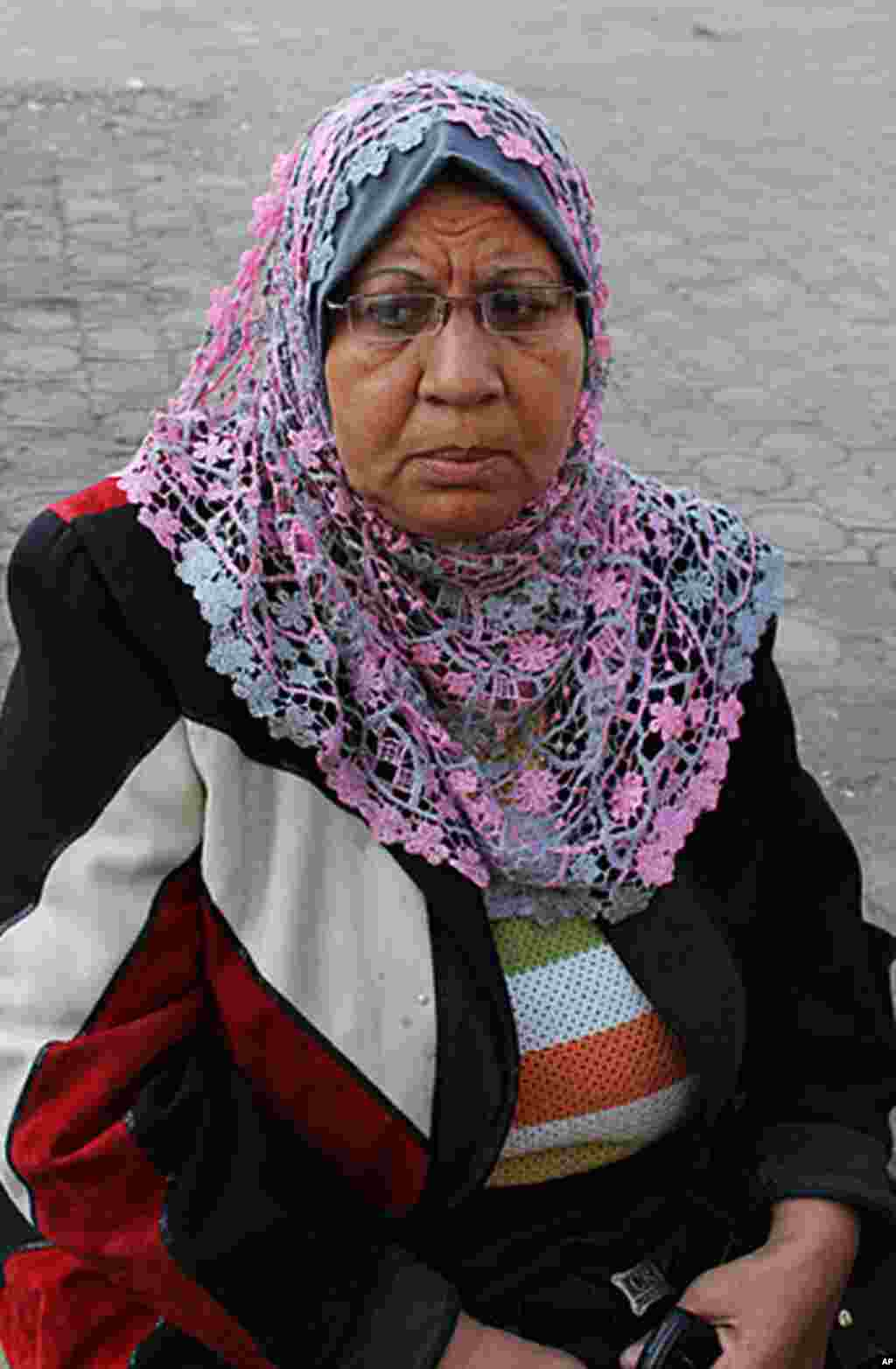 "Rida Eid Mohamed, 60, is a retired nurse says, ""The Military Council has never been against the people - never. And I don't just mean this time. The Egyptian military has protected the people since the war in 1973. People are rioting and the army is only"