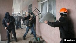 Pro-Russian men storm a police station in the eastern Ukrainian town of Horlivka, April 14, 2014.