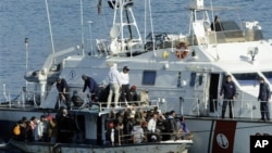 An Italian Coast Guard vessel rescues a boatload of would-be migrants believed to be from North Africa in the waters off the Sicilian island of Lampedusa, Italy, (File)