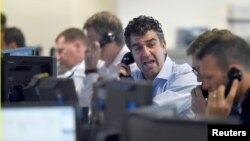 Brokers react on a trading floor at BGC, in the Canary Wharf financial district of London, June 27, 2016.