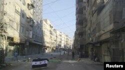 Damashqning al-Tadamun tumanida Suriya muxolifati bayrog'i, 15-iyul, 2012-yil.