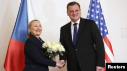 U.S. Secretary of State Hillary Clinton shakes hands with with Czech Prime Minister Petr Necas in Prague December 3, 2012.