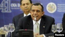 "Porfirio Lobo, the President of Honduras, speaks at a session during the ceremony of the 41st General Assembly of the Organisation of American States (OAS) in San Salvador June 6, 2011. The meeting is themed ""Security in the Americas"", and will see the re"