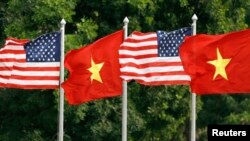 FILE U.S. and Vietnamese flags flutter in the wind at the presidential palace in Hanoi where U.S. President George W. Bush is visiting November 17, 2006.