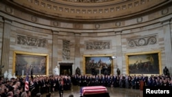 The flag-draped casket of former President George H.W. Bush lays inside the Rotunda of the Capitol in Washington, Monday, Dec. 3, 2018. Pablo Martinez Monsivais/Pool via REUTERS