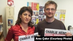 FILE - Stephane Charbonnier, right, editor-in-chief of 'Charlie Hebdo,' was interviewed in 2012 by VOA's Arzu Çakır.