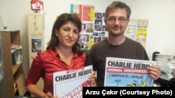 FILE - Stephane Charbonnier, right, editor-in-chief of the French publication Charlie Hebdo, was interviewed in 2012 by VOA's Arzu Çakır. Charbonnier was killed in an attack that left at least 12 people dead, in Paris, France, Jan. 7, 2015.