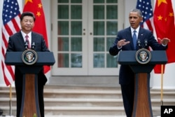 FILE - President Barack Obama gestures during a joint news conference with Chinese President Xi Jinping, Sept. 25, 2015, in the Rose Garden of the White House in Washington.