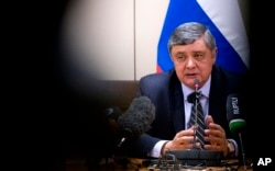 FILE - Russian President Vladimir Putin's special envoy for Afghanistan Zamir Kabulov speaks during a press conference in Brussels, Belgium, Oct. 26, 2017.