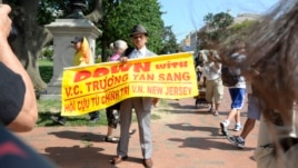 Protesters highlight what they call Vietnam's poor human rights record during a rally near the White House in Washington, D.C, July 25, 2013.