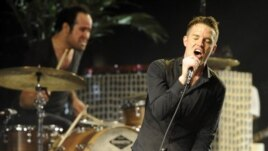 Singer Brandon Flowers and drummer Ronnie Vannucci of The Killers performs during Coachella Valley Music & Arts Festival in Indio, California