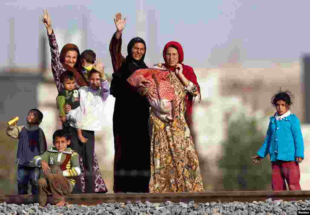 Syrian women from Ras al-Ain are pictured from the Turkish border town of Ceylanpinar, Sanliurfa province, November 11, 2012.