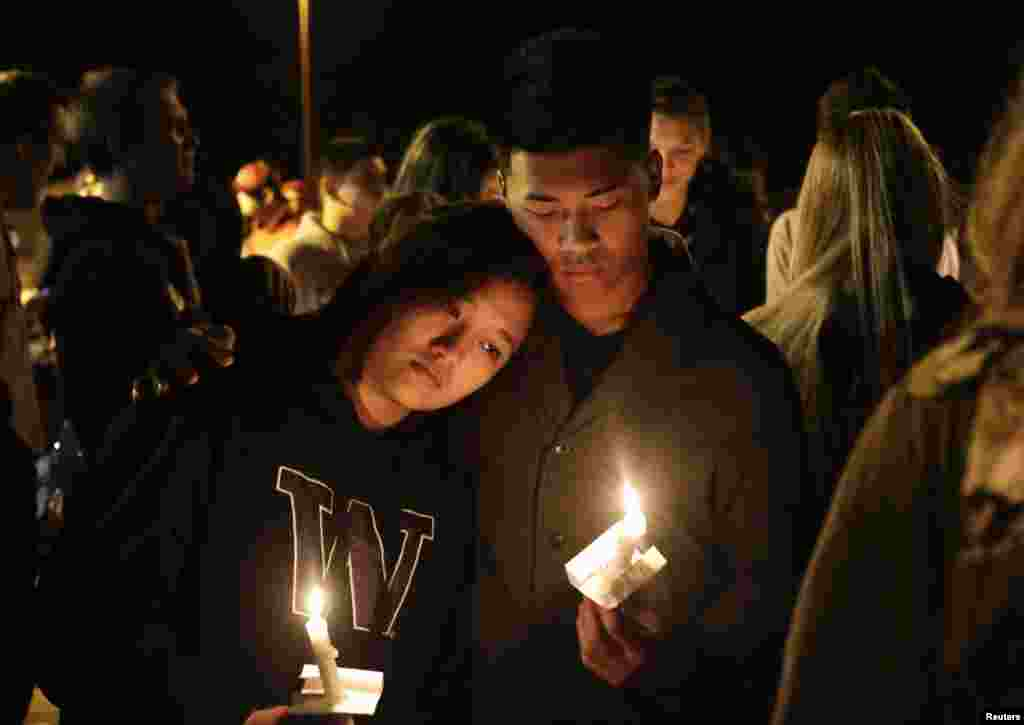 Students and community members attend a vigil at the Grove Church after a shooting at Marysville-Pilchuck High School in Marysville, Washington, Oct. 24, 2014.