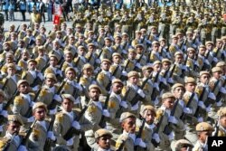 FILE - Iranian army troops march in a parade marking National Army Day just outside Tehran, Iran, April 17, 2016.