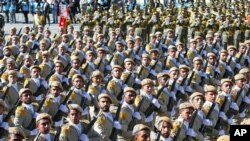 FILE - Iranian army troops march in a parade marking National Army Day just outside Tehran, Iran, April 17, 2016. A new force was announced Thursday, designed to fight in Arab countries and would recruit heavily from non-Iranian Shi'ite Muslims across the region.
