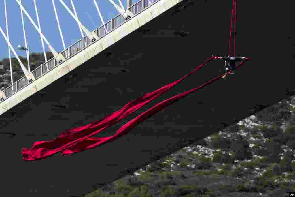 Extreme Aerial dance artist Katerina Soldatou performs on a 34-meter (111 foot) high bridge in the city of Chalkida, about 80 kilometers north of Athens, Greece.