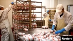 Workers make salami at Akova Impex Meat Industry Ovako, which makes halal-quality certified products, in Sarajevo, Bosnia and Herzegovina, Dec. 2, 2016.