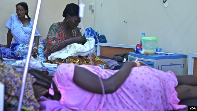 Mothers who have just given birth sit on some of the hospital's eight maternity beds, Juba, South Sudan. (H. McNeish/VOA)