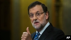 FILE - Spain's Prime Minister Mariano Rajoy gestures during a state of the nation debate at the Spanish Parliament in Madrid.