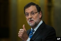 Spain's Prime Minister Mariano Rajoy gestures during a state of the nation debate at the Spanish Parliament in Madrid, Feb. 24, 2015.