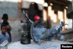 The remains of an exploded missile are seen near a house damaged by overnight shelling in Abu Salim district, Tripoli, Libya, April 17, 2019.