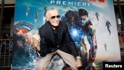 "FILE- Stan Lee gestures as he poses at the premiere of ""Iron Man 3"" at El Capitan theater in Hollywood, California, April 24, 2013."