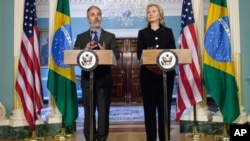 Secretary of State Hillary Rodham Clinton and Brazilian Foreign Minister Antonio de Aguiar Patriota, make remarks after a meeting at the State Department in Washington, Wednesday, June 1, 2011. (AP Photo/Evan Vucci)