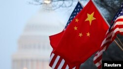 The People's Republic of China flag and the U.S. Stars and Stripes fly along Pennsylvania Avenue near the U.S. Capitol in Washington during Chinese President Hu Jintao's state visit