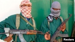 FILE - Two al-Shabab fighters are seen in Mogadishu, Somalia, in a 2008 photo.