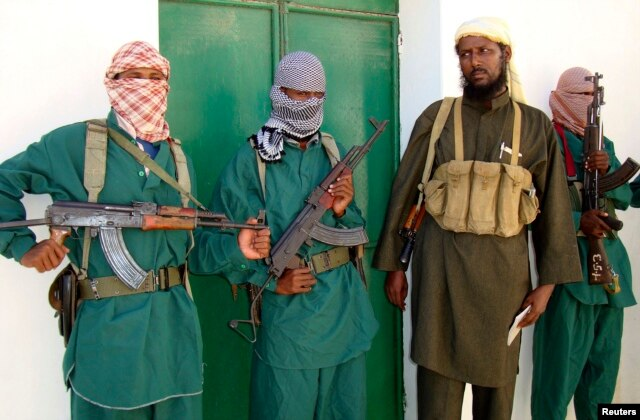 FILE - Sheik Muktar Robow Abu Mansur (2nd R), spokesman of Somalia's Islamic al-Shabab, leaves a news conference after vowing to step up attacks against government soldiers and foreign troops in Mogadishu, Dec. 14, 2008.