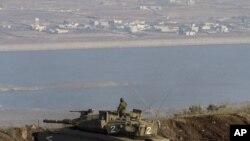 Израильский танк на израильско-сирийской границе