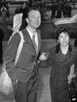 FILE - Pete Seeger and his wife, Toshi, arrive at the federal court in New York for sentencing on a conviction for contempt of Congress, April 1961. The FBI released more than 1,700 pages of documents it collected on the folk singer.