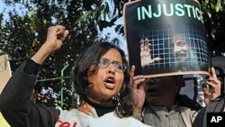 Indian students, teachers, Women Association and political activists hold placards as they shout anti-government slogans in New Delhi during a protest against life sentence handed out to a doctor and social activist, Binayak Sen, 27 Dec 2010