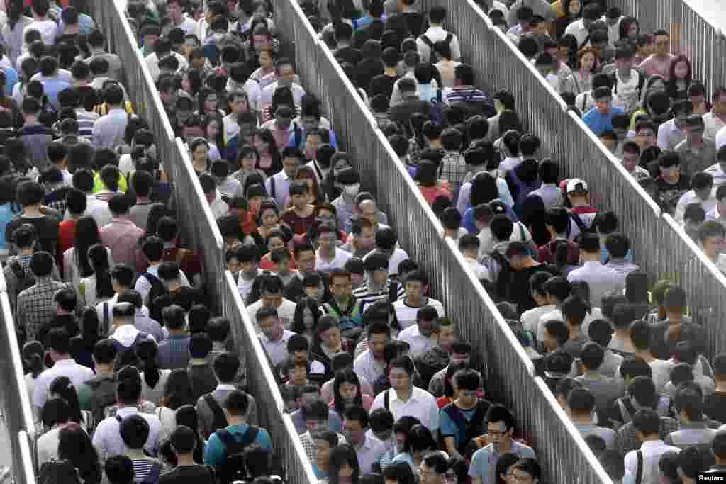 Passengers line up and wait for a security check during morning rush hour at Tiantongyuan North Station in Beijing. China tightened security checks at subway stations following an attack in country's troubled Xinjiang region which killed 31 people on May 22.