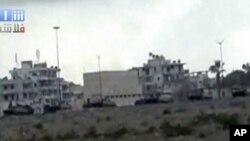 Tanques na cidade de Latakia