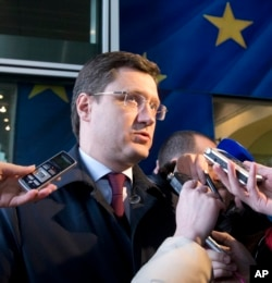 Russian Energy Minister Alexander Novak speaks with the media as he arrives at EU headquarters in Brussels, March 2, 2015.